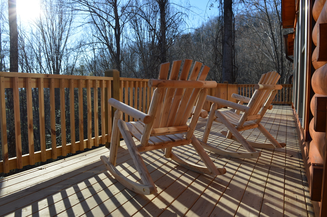 sunny deck with rocking chairs at the log cabin