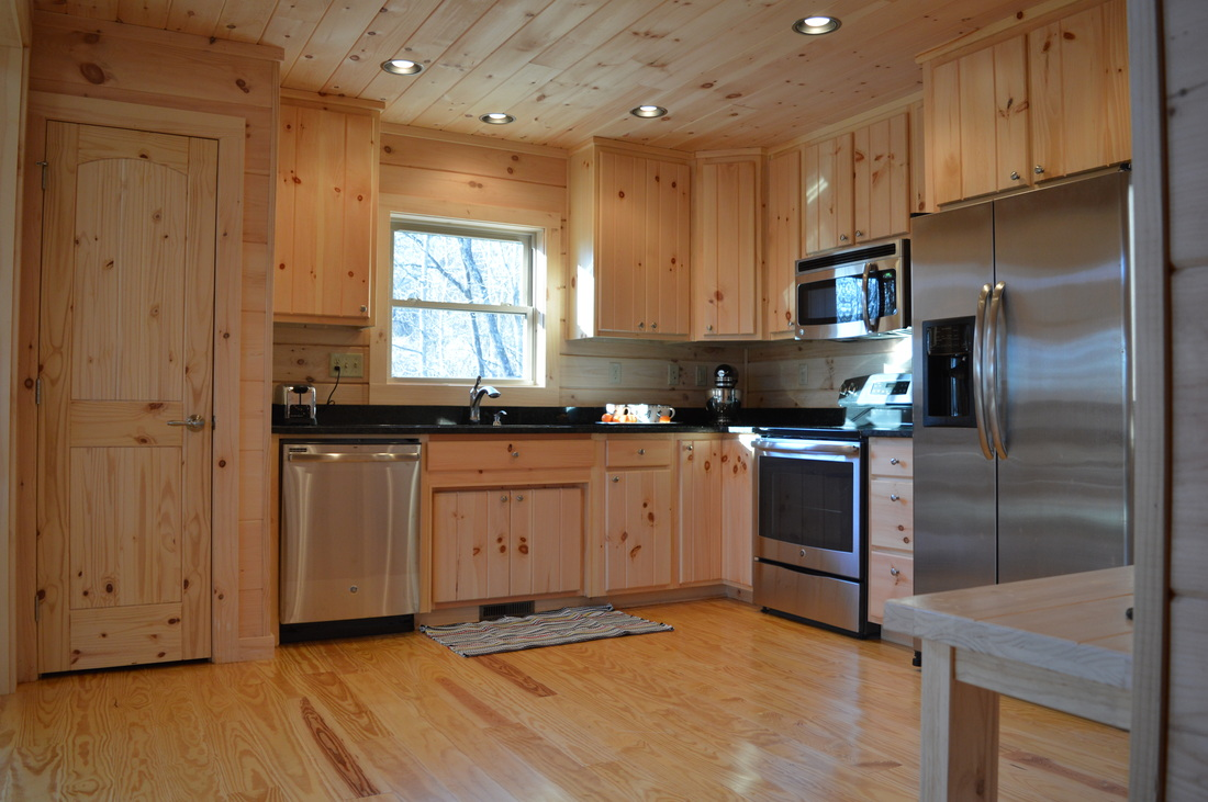 stainless steel appliances in log cabin kitchen
