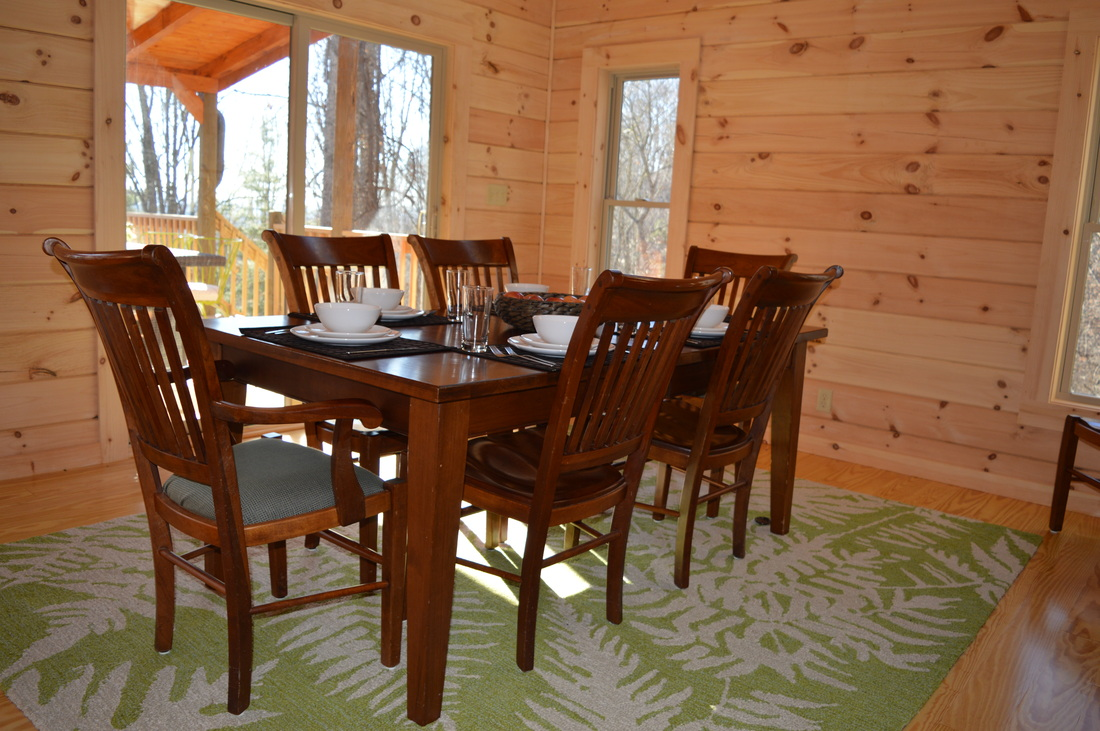 dining table for family dinners at vacation rental log cabin