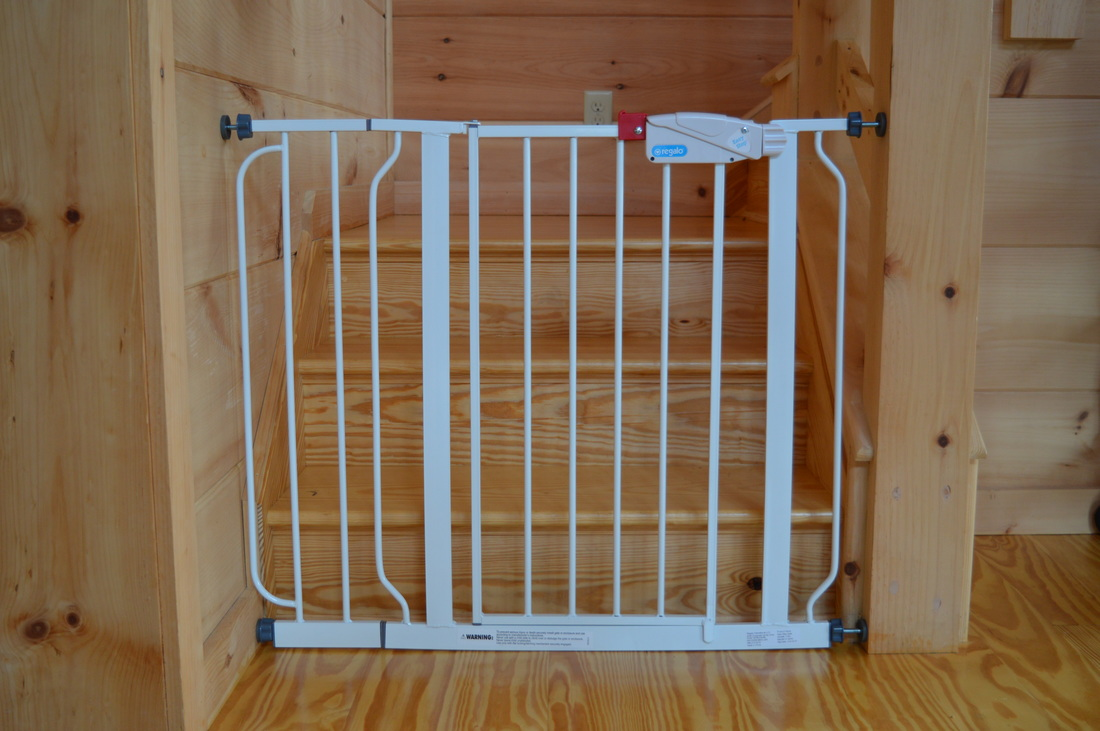 childproofing babygate at vacation rental log cabin